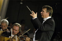 Mikhail Pletnev, founder and artistic director of the RNO, conducts